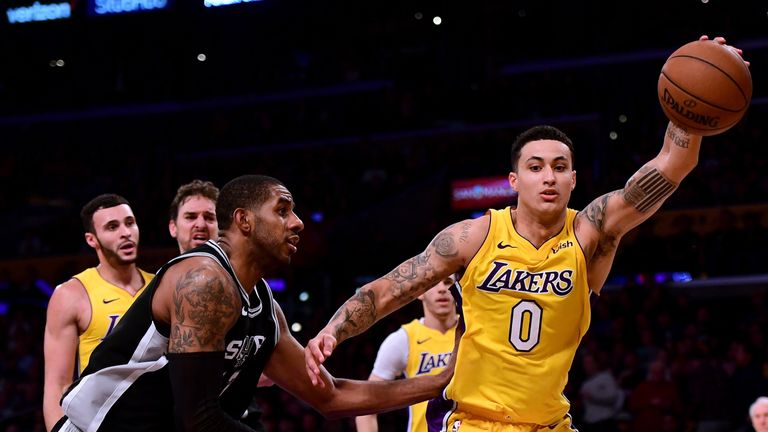 Kyle Kuzma #0 of the Los Angeles Lakers grabs a rebound in front of LaMarcus Aldridge #12 of the San Antonio Spurs during a 93-81 Laker win at Staples Center on January 11, 2018 in Los Angeles, California.