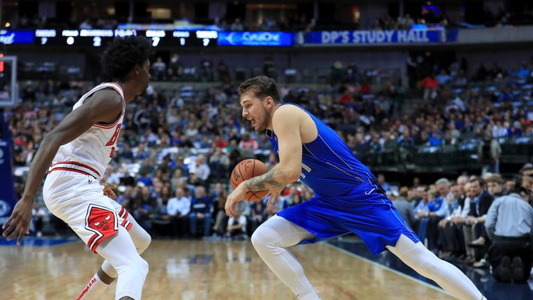 Luka Doncic #77 of the Dallas Mavericks drives to the basket against Justin Holiday #7 of the Chicago Bulls at American Airlines Center on October 22, 2018 in Dallas, Texas