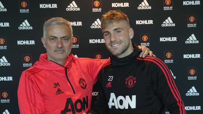 Luke Shaw shakes hands with Jose Mourinho after signing a new long-term contract with Manchester United