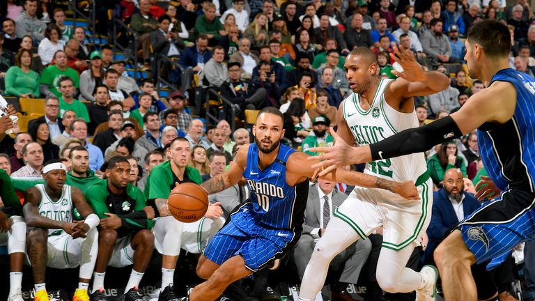 Evan Fournier #10 of the Orlando Magic handles the ball against the Boston Celtics on October 22, 2018 at the TD Garden in Boston, Massachusetts.