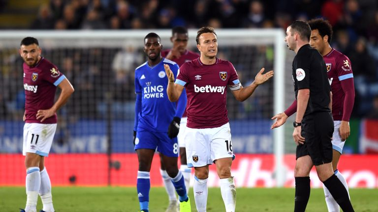 West Ham's Mark Noble reacts after referee Michael Oliver showed him a red card at Leicester