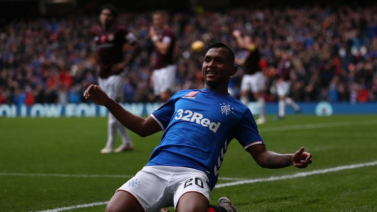 Alfredo Morelos slides on his knees after doubling Rangers' lead on Sunday