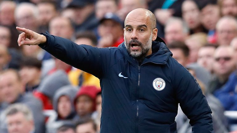 Pep Guardiola gestures on the touchline at Anfield
