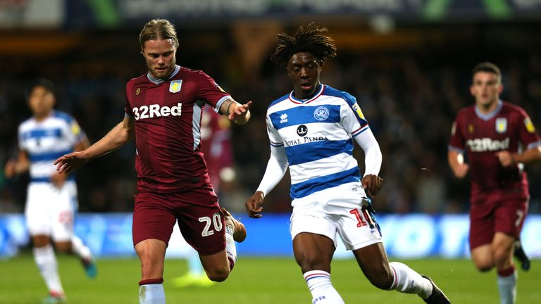 Birkir Bjarnason and Eberechi Eze battle for the ball