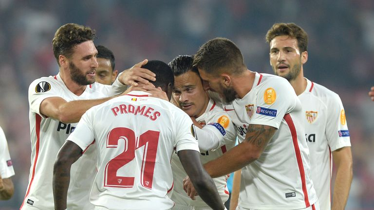 Sevilla's Spanish midfielder Roque Mesa (C) celebrates after scoring
