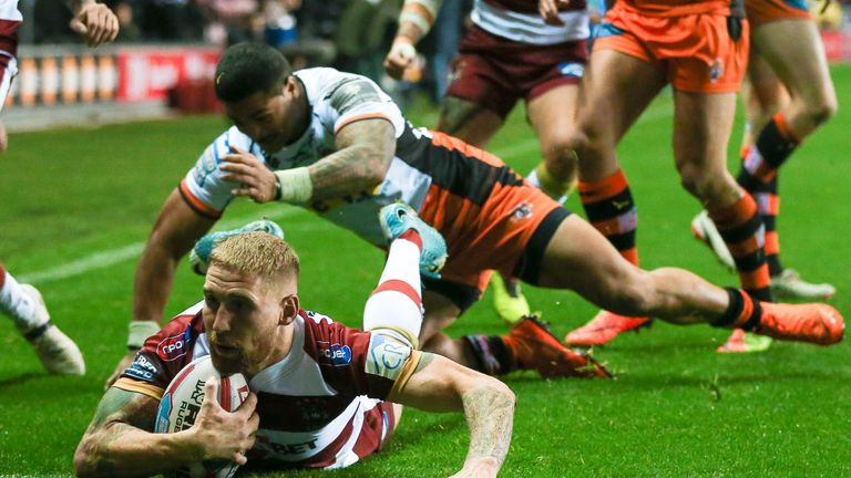 Wigan's Sam Tomkins scoring a try during their semi-final victory