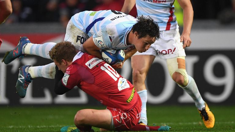 Racing centre Henry Chavancy is tackled by Scarlets' Angus O'Brien