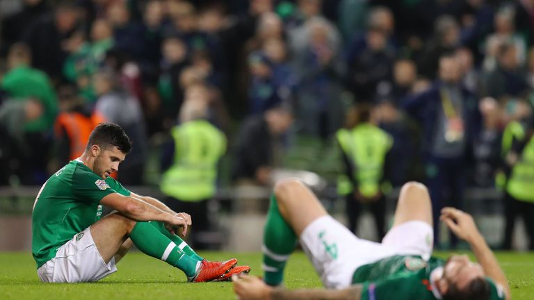 Shane Long and Shane Duffy (right) react after Ireland's loss to Wales