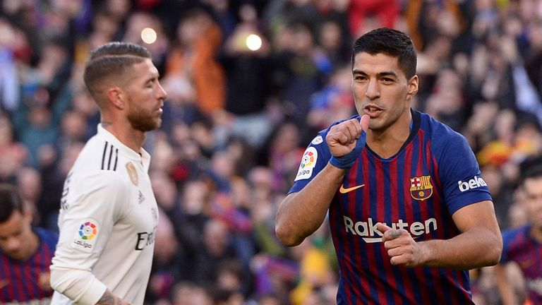 Luis Suarez scored a hat-trick as Barcelona beat Real Madrid 5-1