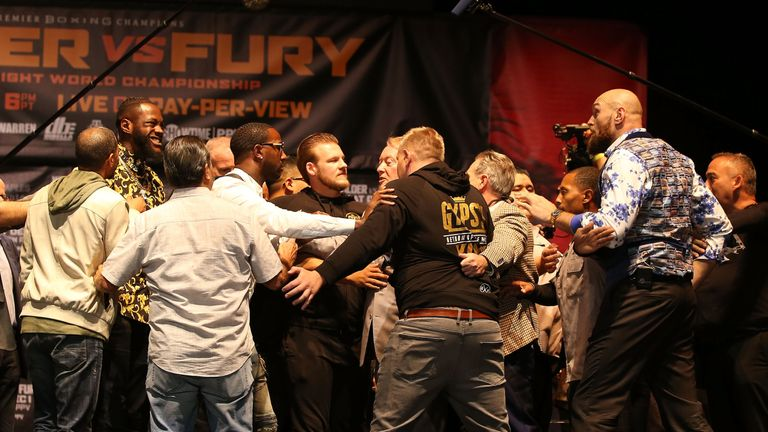 Fury (right) and Wilder clash at their final news conference in Los Angeles
