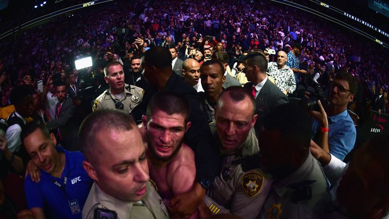 Khabib Nurmagomedov is escorted out of the arena in Las Vegas
