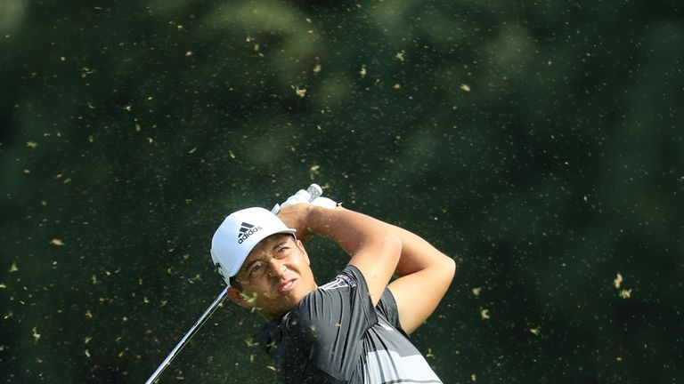 Tony Finau leads HSBC Champions despite hitting sprinkler