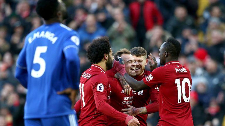 Xherdan Shaqiri celebrates with team-mates after scoring Liverpool's third goal