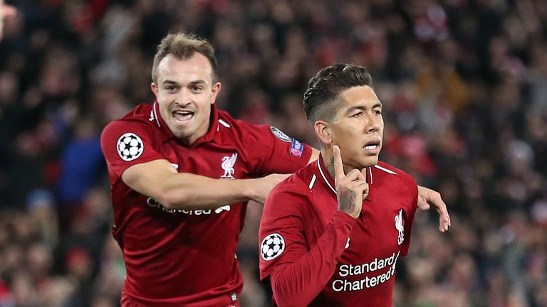 Shaqiri celebrates Roberto Firmino's goal against Red Star at Anfield