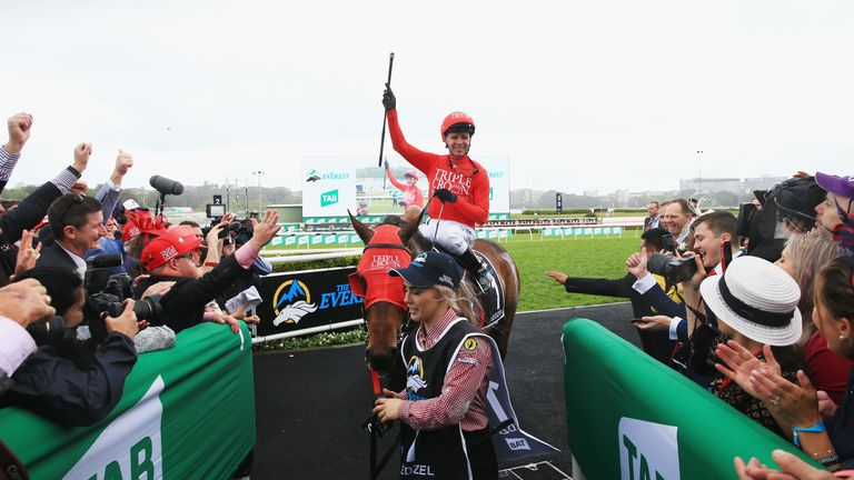 Kerrin McEvoy celebrates as Redzel wins the Everest