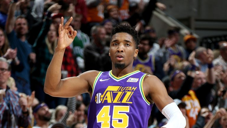 Donovan Mitchell is action for the Utah Jazz against the Boston Celtics