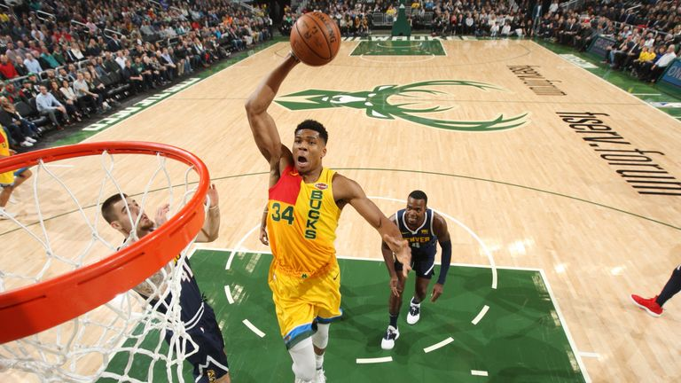 Giannis Antetokounmpo dunks on the Denver Nuggets