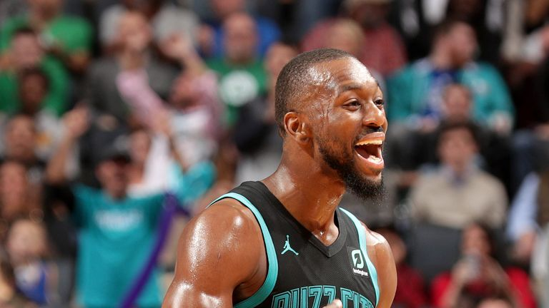 Kemba Walker celebrates on his way