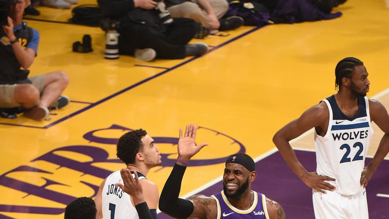 LeBron James high-fives team-mate Josh Hart