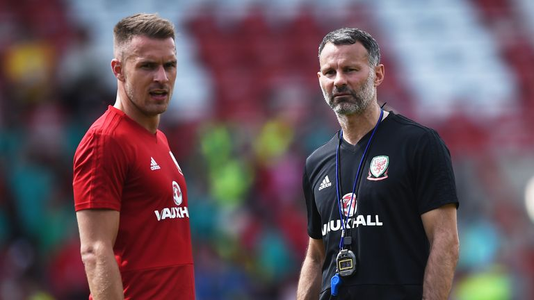Ryan Giggs, manager of Wales, talks to Aaron Ramsey