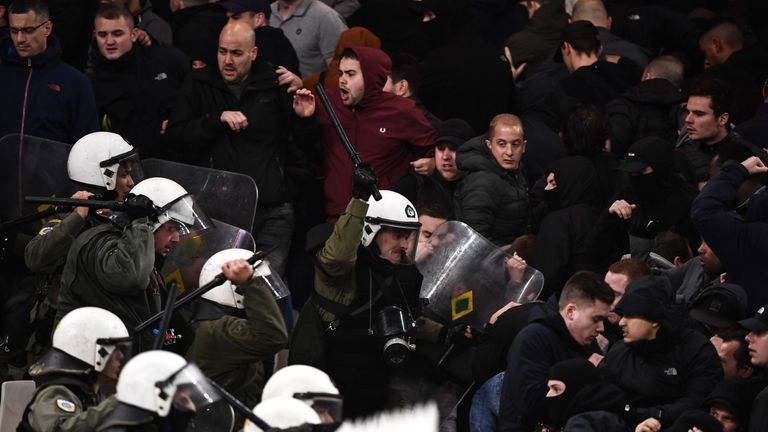 Ajax's fans clash with Greek riot police prior to the start of the UEFA Champions League football match against AEK Athens