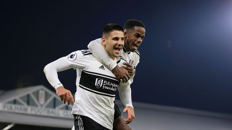 Aleksandar Mitrovic celebrates with team-mate Ryan Sessegnon after Fulham take a 3-2 lead