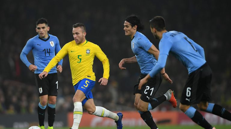 Arthur in action for Brazil against Uruguay