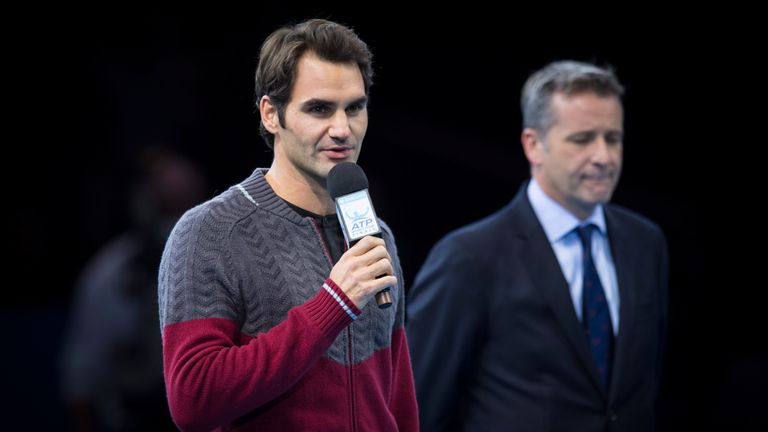 Federer announcing to the crowd that he wouldn't be able to compete in the 2014 final