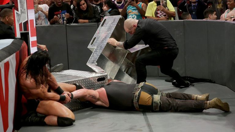 Braun Strowman was left and out after a savage attack by Baron Corbin and Drew McIntyre and will now have surgery on an injured elbow