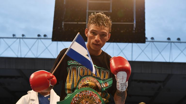 Cristofer Rosales celebrates after defeating Paddy Barnes