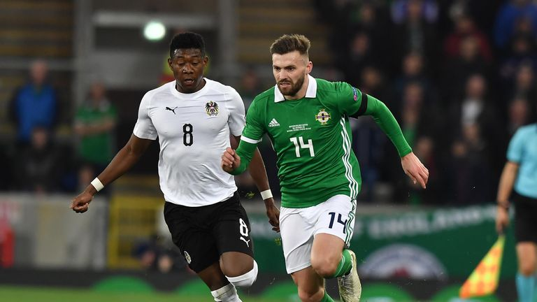 Stuart Dallas and David Alaba compete during the game at Windsor Park