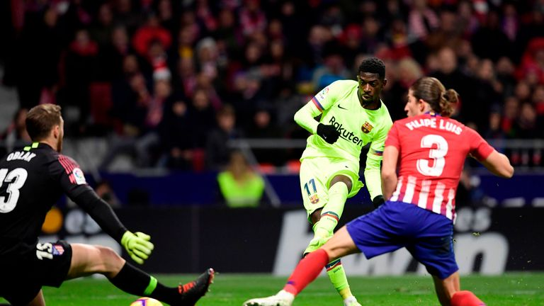 Dembele strikes the ball past the onsrushing Jan Oblak