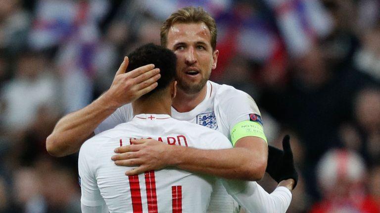 Harry Kane embraces fellow goalscorer Jesse Lingard