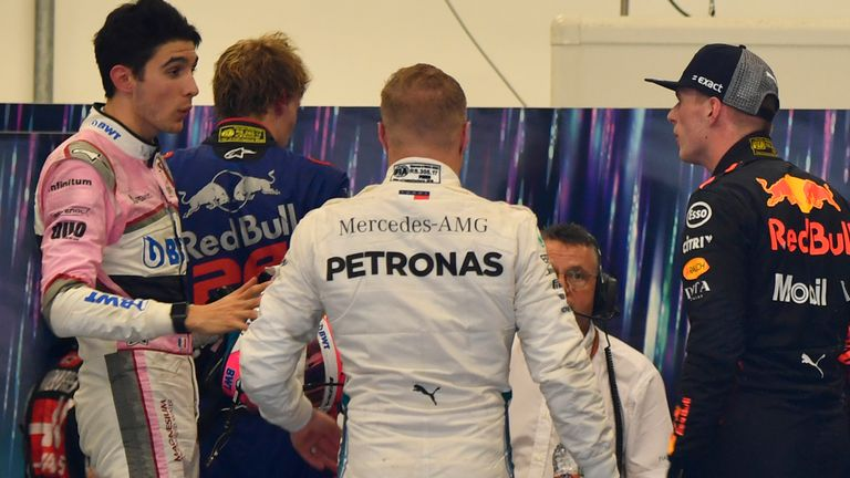 A furious Max Verstappen remonstrates with Esteban Ocon following their clash during the Brazilian GP which saw Verstappen lose the lead.
