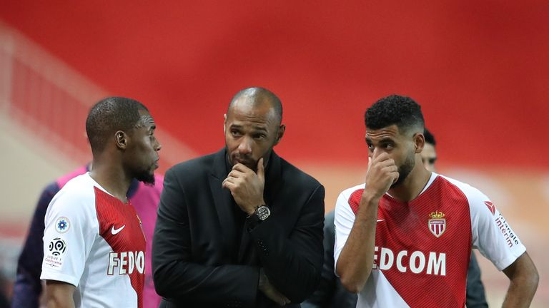 Thierry Henry chats to his beleaguered players