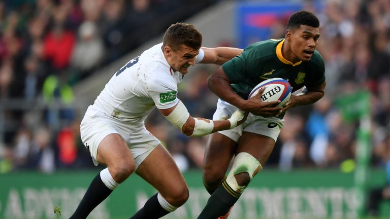 Damian Willemse tries to break from Henry Slade