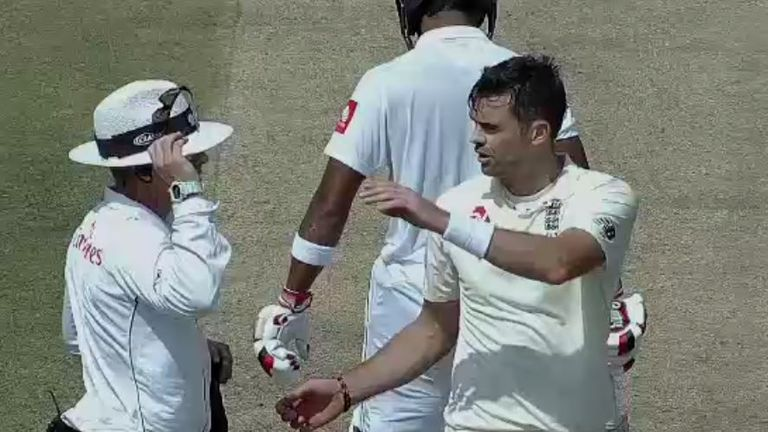 Umpire Chris Gaffaney speaks to England's James Anderson on day two of the first Test