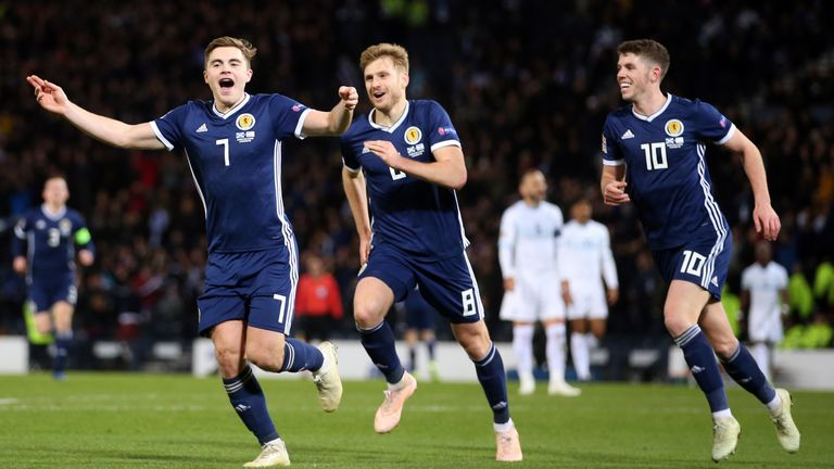 Scotland's James Forrest (left) celebrates scoring his side's second goal of the game with Stuart Armstrong (centre) and Ryan Christie during the UEFA Nations League, Group C1 match at Hampden Park, Glasgow. PRESS ASSOCIATION Photo. Picture date: Tuesday November 20, 2018. See PA story SOCCER Scotland. Photo credit should read: Jane Barlow/PA Wire. RESTRICTIONS: Use subject to restrictions. Editorial use only. Commercial use only with prior written consent of the Scottish FA.