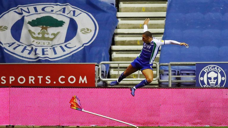 Wigan Athletic's James Vaughan celebrates scoring his side's second goal against Blackburn Rovers