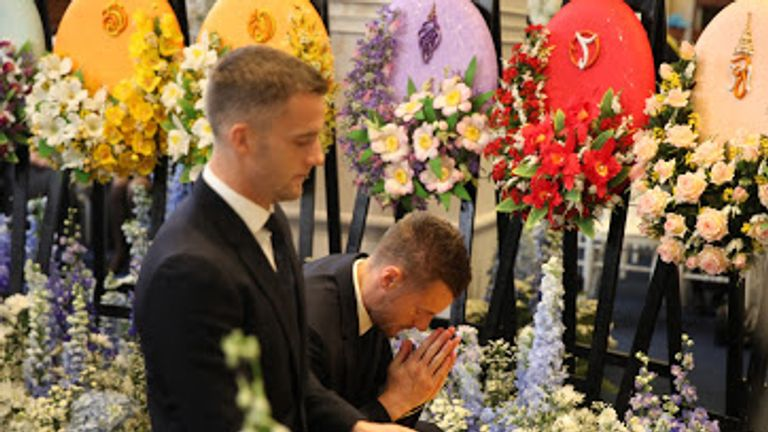 Jamie Vardy and Andy King of Leicester pay their respects at Wat Thepsirin temple in Bangkok