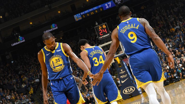Kevin Durant shakes the hand of Andre Iguodala during Hawks @ Warriors