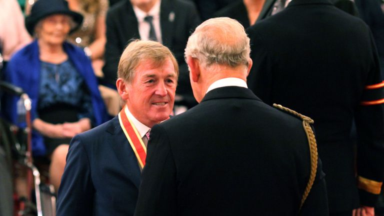 Liverpool legend Sir Kenny Dalglish is knighted by the Prince of Wales at Buckingham Palace