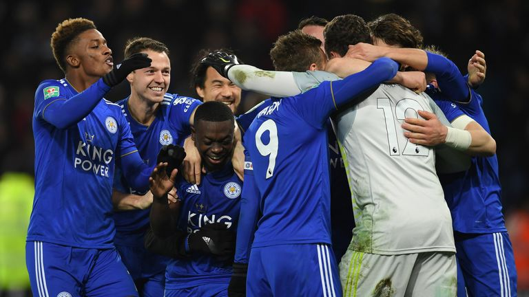 Goalkeeper Danny Ward is mobbed by his Leicester team-mates after their penalty-shoot-out win