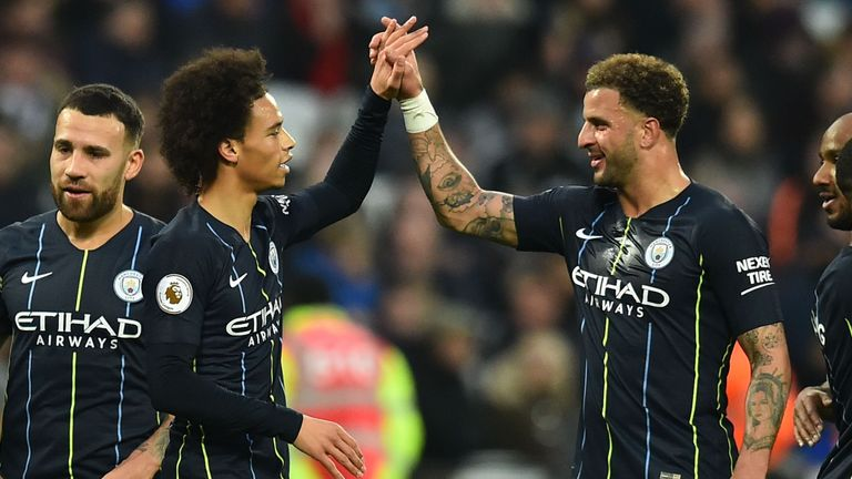 Leroy Sane celebrates scoring Manchester City's third goal with Kyle Walker