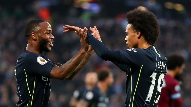 Leroy Sane celebrates with team-mate Raheem Sterling after scoring Manchester City's third goal