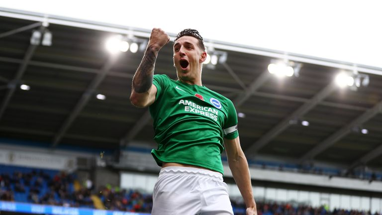 Lewis Dunk celebrates Brighton's goal against Cardiff
