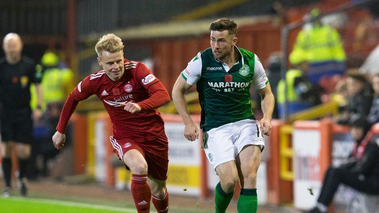 Hibernian's Lewis Stevenson (R) in action with Aberdeen's Gary Mackay-Steven