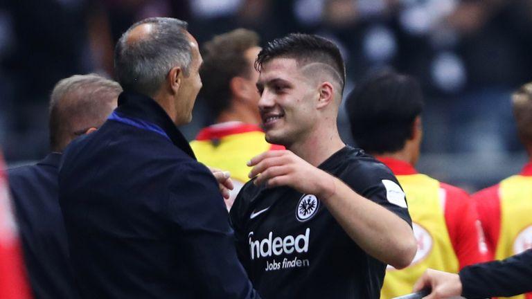 Jovic hugs Eintracht Frankfurt manager Adi Hutter after scoring five goals against Fortuna Dusseldorf