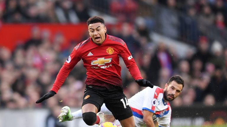 Luka Milivojevic fouls Jesse Lingard in the first half at Old Trafford