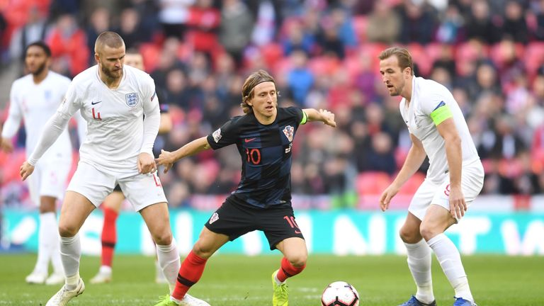 Luka Modric gets away from Eric Dier and Harry Kane